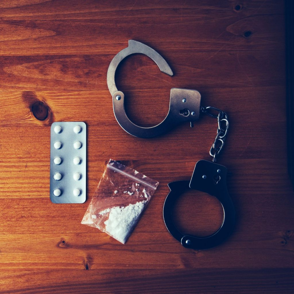 collected drugs and cuffs for drug charges